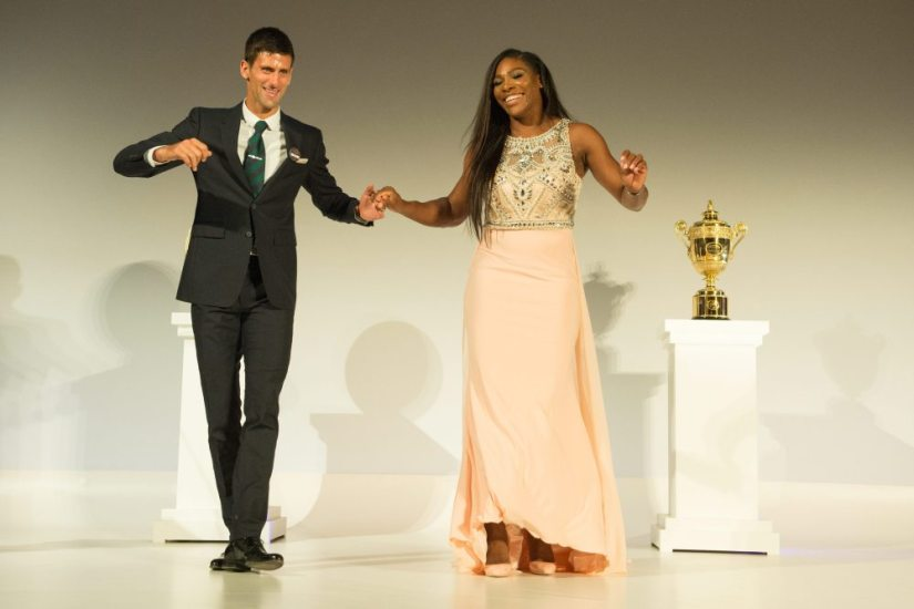 epa04844742 Novak Djokovic of Serbia (L) and Serena Williams of the US (R) dancing on stage at the Wimbledon Champions Dinner  at the Guild Hall in London, Britain, 12 July 2015.  EPA/Thomas Lovelock /AELTC HANDOUT   EDITORIAL USE ONLY/NO SALES